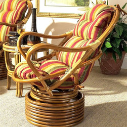 Boca Rattan - Delta Rattan Swivel Rocker w Cushion (957) - Fabric: 957Graceful curves and a modern base crafted from multiple stacked rings gives this wood and rattan swivel rocker an appealing look that will be an inviting addition to a patio or sun porch. The rocker is available in your choice of finishes and cushion fabrics. Cushion included. Indoor use only. Leather bindings. Constructed from strong and durable rattan. Pictured in Royal Oak. 32 in. L x 30 in. W x 40 in. H (40 lbs.)