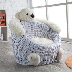 Willow Bear Chair - White - Warm the Willow Bear Chair - White with a great big bear hug. This durable wicker chair offers a cozy lap for your little one to curl up on at naptime. Designed just for kids, this bear chair is woven in a slightly reclined oval shape that your little ones will sink into. The wicker aesthetic blends easily to any home decor and the soft white hue is true to the bear ornamentation.The soft teddy bear features an adorable face that watches diligently over your embracing youngster with two eyes, ears and a snout with a cute bear smile. The two furry arms reach along the top of the chair serving as armrests but double as headrests. The bear's two feet sit at the foot of the chair, kicking back in comfort. Count on your kid having a new favorite seat in your home and definitely a new nap buddy.