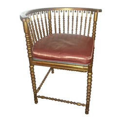 """Heywood-Wakefield - Pre-owned Heywood Wakefield Gilded Corner Chair C. 1898 - A Heywood Wakefield gilded corner chair, circa 1898.     The Heywood Brothers teamed up with Wakefield Rattan in 1897 and it wasn't until 1920 that they added the well known eagle to their label. This piece is pre-1920 and made right at the turn of the century.     This rare piece is sturdy with all original screws and nails. The gilding has a nice patina which takes away the """"brassy"""" look you sometimes see with Victorian pieces. The chair has many unique details and is reminiscent of the stick and ball style. The cushion is copper colored."""