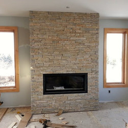 Low-Height Ledgestone - This fireplace features The Quarry Mill's Primavera natural stone veneer in custom heights.