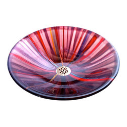 "Brock Madison Glass LLC - Star Fire glass sink vessel - A ""Burst of Color"" comes to mind when viewing this vessel.  Strips of cut colored glass are stacked vertically and allowed to topple over onto each other in the heat of the kiln.   The result creates overlapping lights and darks for a nice tonal range of lavender,blue,reds and orange colors for this star burst patterned sink vessel.  Gold, blue metal accent colors for added luster."