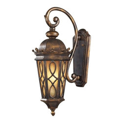 """Elk - Montreal Park Amber 23"""" High Outdoor Wall Light - The fine craftsmanship is evident in the cast aluminum details and scrollwork. The Amber Scavo glass is enhanced by a swirled pattern with a hazelnut bronze finish. Although it looks antique it functions like a modern light with ample light output. Welcome guests with this charming entrance lantern. Cast aluminum. Hazelnut bronze finish. Amber Scavo glass. Takes two 60 watt candelabra bulbs (not included). 9"""" wide. 23"""" high. Extends 12"""" from wall.  Cast aluminum.   Hazelnut bronze finish.  Amber Scavo glass.   Takes two 60 watt candelabra bulbs (not included).  9"""" wide.  23"""" high.  Extends 12"""" from wall."""
