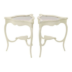 """Pre-owned Vintage Swedish Style Vitrine Tables - A Pair - Two curvy cream painted side tables with space for small collections under each glass top. The triangle shape is very useful in arranging furniture. And the storage area helps keep your collections on view, but uncluttered. The display area is about 2"""" deep, under the glass. The tops are hinged on one side. The triangle tops are 25.5"""" on each side, and about 24"""" across.    Very good vintage condition. Finish was applied over mahogany by prior owner - well done with some distressing, visible in photos. They are currently lined with red fabric."""