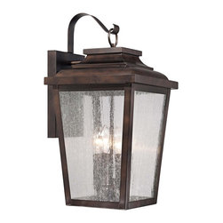 "Minka Lavery - Country - Cottage Irvington Manor 20 3/4"" High Bronze Outdoor Wall Light - This outdoor wall light looks great near garage doors entryways and porches. A handsome Chelsea bronze finish is paired with clear seedy glass and durable aluminum construction for a classic look and feel that works with any home. Candelabra bulbs offer a warm soft glow so you can feel both safe and stylish. From the Minka Lavery Irvington Manor Collection. Chelsea bronze finish. Clear seedy glass. Aluminum construction. Takes four 60 watt candelabra base bulbs (not included). Metal candle sleeves. 20 3/4"" high. 10 1/2"" wide. Extends 11 3/4"" from the wall.  Chelsea bronze finish.  Clear seedy glass.  Aluminum construction.  Takes four 60 watt candelabra base bulbs (not included).  Metal candle sleeves.  20 3/4"" high.  10 1/2"" wide.  Extends 11 3/4"" from the wall."