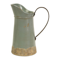 iMax - Calista Tall Pitcher with Metal Handle - A pale aqua rustic ceramic pitcher has a natural quality like a handmade collectible piece from ancient civilizations. This piece is highly versatile and well suited for a variety of decor.
