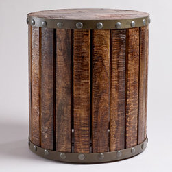World Market - Wood Plank Drum Table - Our Wood Plank Drum Table is a unique accent table with an industrial style that suits any design décor. Each table is authentically handcrafted by artisans in India. Hand-fired mango wood planks create a sturdy base around its durable iron frame for a real statement piece. An iron frame in a distressed zinc finish and large rivet details completes its handmade appeal.