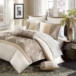 Madison Park - Madison Park Crystela 7pcs Comforter Set - The Crystela collection provides elegance to your home. The top of the comforter is a mix of ivory and neutral tones that are pieced with a center section of embroidered leaves. Comforter top is made from 100% polyoni fabric and the reverse is made from polyester brushed fabric. Comforter set includes comforter, shams, bedskirt and three decorative pillows. Comforter & Sham: 100% polyoni pieced with emb, 100% polyester brushed fabric back, 270g/m2 poly fill. Bedskirt: 100% polyester drop, poly platform; Pillow: 100% polyoni cover with polyester fill