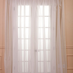 Solid Off White Double Wide Voile Poly Sheer Curtain - These beautiful and classic double wide solid voile poly sheer curtain panels come two in the set for extra value. These sheer panels are unmatched in quality and design. They create a warm atmosphere with beautiful light diffusion.