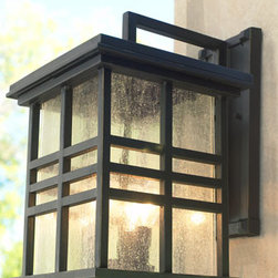 Three Light Wall Lantern - This large Three Light coach lantern, designed in a weathered bronze finish, is designed to be hung on the wall where it will add delightful style to any outdoor decor.