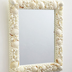 Triton Shell Mosaic Wall Mirror - I adore stunning shell art, whether purchased or made. A creation like this mirror would make a fabulous summer-long project for mom and kids, and the memories sourcing all the shells would be amazing too.