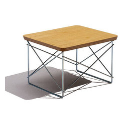Charles & Ray Eames - Herman Miller Eames Wire-Base Table - Herman Miller Eames Wire Base Table  designed by Charles and Ray Eames      At A Glance:   Any interior can be brightened up with a little Eames, and the small Eames Wire Base Table bears all the hallmarks of classic Eames design - the use of welded wire rods in the base, molded plywood in the surface, and beveled edge that reveals the essential material (the wood plies) beneath the surface. Line a few of them up to work like a coffee table. Use them as bedside tables. Stack one on top of another to serve as an end table next to a sofa. Scatter them around a room. Use them to serve hors d'oeuvres and drinks.      What's To Like:   The table's compact size and light weight make it easy to move to wherever you need a small, attractive surface. You can even stack a few of them out of the way when you're not using them. Sometimes it's the small things that make the biggest statements - and