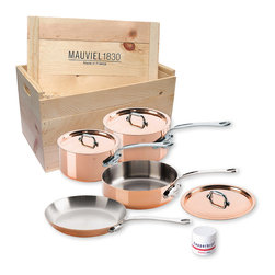 Mauviel M'Heritage M'150s 7 Piece Copper Cookware Set W/ Wooden Crate - The Mauviel M'Heritage 7 piece cookware set allows you to cook with unsurpassed heat conductivity and control thanks to it's 90% copper  10% stainless steel construction.  The M'150s collection features classic cast iron handles  stainless rivets  a polished copper exterior  and an 18/10 stainless interior.  The cookware has a thickness of 1.5 mm  and the copper exterior allows for superior heat conduction and control.  The M'Heritage collection represents the total experience and heritage of Mauviel 1830.  This set comes packaged in a traditional and attractive wood crate  a great touch for gift presentation.  Set includes      1.9 qt Saucepan (6410.17)   1.9 qt Saucepan Lid   3.2 qt Saute Pan (6411.25)   3.2 qt Saute Pan Lid   3.6 qt Saucepan (6410.21)   3.6 qt Saucepan Lid   10.2 in Fry pan   Copperbrill Cleaner     Product Features      Bilaminated copper stainless steel - 90% copper and 10% 18/10 stainless steel   Copper cookware heats more evenly and much faster than other metals  and offers superior cooking control   1.5 mm thickness   18/10 stainless steel interior preserves the taste and nutritional qualities of foods and is easy to clean   Mauviel M'150s cookware can be used on gas  electric  halogen stovetops  and in the oven. It can also be used on induction stovetops with Mauviel's induction stove top interface disc (sold separately)   Mauviel cookware is guaranteed for life against any manufacturing defects (Warranty not valid for commercial use)   Made in France