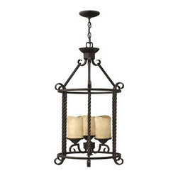 Hinkley Lighting - Hinkley Casa Olde Black Three-Light Mini-Chandelier - Casa makes the most of its fine details- individually unique antique scavo glass twisted wrought iron and hand-forged scrollwork in an Olde Black finish complete its rustic-chic appeal with a Southwestern flair.Under four generations of family leadership Hinkley Lighting has transformed from a small outdoor lantern company to a global brand intent on bringing you the best in style quality and value. LIFE AGLOW: That's their mantra and they take it seriously. By welcoming their products into your home they become part of your family's everyday life illuminating small moments and big occasions. They understand your home is so much more than a physical place. It's an emotional space designed by you so they are committed to keeping your 'Life Aglow' with stylish state-of-the-art lighting. Their products are the ultimate combination of style and substance. They are constantly developing new technologies to make their fixtures even more energy efficient. Hinkley recently upgraded their LED to cutting-edge high lumen output integrated solutions and they give you hundreds of energy-efficient styles to choose from. Even their Cleveland-based world headquarters employs high energy saving standards with low VOC materials and a variety of eco-smart applications into the design to make an earth-friendly work environment for their Hinkley family. Hand crafted fixtures luxe finishes artistic details and quality materials go into the design of every product they make. They embrace the philosophy that you can merge together the lighting furniture art and accessories you love into a beautiful environment that defines your own personal style.