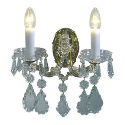 """Inviting Home - Maria Theresa Crystal Sconce (Premium Crystal) - Maria Theresa style crystal sconce with cut crystal trimmings; 12""""W x 9""""D x 12""""H; assembly required; 2 light premium Maria Theresa style crystal sconce with hand-molded arms and cut crystal trimmings; all metal parts have gold finish; genuine Czech crystal; ready to ship in 2 to 3 weeks; This wall sconce is a part of Maria Theresa Collection. At their start the chandeliers bearing the name of Maria Theresa were made on the occasion of the Empress's coronation as queen of Bohemia in 1743. This fact is hidden in the shape of these lighting fixtures reminiscent of the royal crown. Their characteristic feature is the arms' typical flat surface clad with glass bars. The bars are fixed to the arms by glass rosettes and beads with dangling cut crystal chandelier trimmings. These ravishing fixtures were inspired by a chandelier made for Maria Theresa in Bohemia in the mid 18th century. However not only the empress became fond of it; so did many others who fancied the style and the majestic manners after her. Typical elements are metal arms overlaid with glass bars and decorated with crystal rosettes. Originally the trimming was made of typical flat drops called """"pendles"""". Today trimmings of various shapes are used. Premium crystal. A sumptuous type of chandelier trimmings. Fire of the rainbow spectrum brilliance limpidity glitter and perfect scattering and dispersion of light - these are their main features resulting from precise cutting using electronically controlled machines but also from high quality crystal containing more then 30% of lead. Traditional mastery and the revealed mystery of the glass substance blend together with modern technologies and first-rate design in each of these unique pieces. Chandeliers dressed with these trimmings of exceptional beauty will lend an air of grandeur to the ambiance even of the most prestigious interiors. Every component passes thorough strict internal Quality Contr"""
