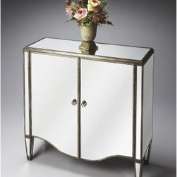 Butler Door Chest - Mirror - A sparkling way to add style to your space, the Butler Door Chest - Mirror brings glamour home. This chest has a classic design made of durable wood accented by antiqued mirror inlays on the top, sides, doors, and legs. Open the double doors to reveal an adjustable shelf and plenty of space.About Butler SpecialtyButler Specialty Company has been designing and manufacturing high-quality occasional and accent furniture since 1930. Each piece reflects Butler's dedication to enduring design, exquisite craftsmanship, and top-quality materials. This family-owned company is based in Chicago. They scour the globe in search of the finest materials and most efficient means of production, reflecting their commitment to providing excellent quality at exceptional value.