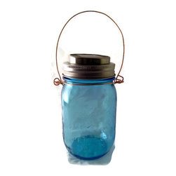 Blue Ball Jar  Mason Jar Hanging Light  Solar Light - This Blue Ball Mason Jar Hanging Solar Light  is handmade from a repurposed new one pint American Heritage Collection Vintage Style Blue Ball jar. The cap has a solar light  unit.  The handle is handmade from 14 gauge solid copper wire and is sturdy and weather resistant. I put a small coat of silicone on the top of the jar ring and the solar unit  to prevent moisture from getting in. This light will look charming hanging from a tree or a Shepard's hook or just sitting on the tabletop.