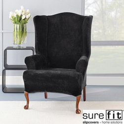 Sure Fit - Stretch Plush Black Wing Chair Slipcover - Make your chair look new again with this black wing chair slipcover. Made of a stretch plush knit fabric with spandex,this comfortable slipcover will contour to fit your chair. This slipcover is machine washable for easy maintenance.