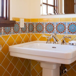 Fireclay Tile - Cuerda Seca - This bright and colorful installation features our Debris Series recycled tile, in color Daffodil accented by one of our Moorish Knot Cuerda Seca's. We love the bold color choice, and the beautiful accents of this project.