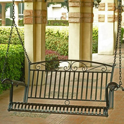 International Caravan - Tropico Porch Swing in Black-Finished Iron - Looking to add an idyllic accent to your outdoor area? You won't want to ignore this porch swing from the Tropico line. The piece has rugged iron construction, rich black finish, rust-proof enhancements and meticulous scrollwork. Optional cushion is available. In black finish. Made of iron. Tropico design. Uses EP Rust Protection for extended longer lasting outdoor protection, equipped with chains. Wider unique arm rests. Swing: 47 in. W x 21 in. D x 36 in. H. Option to add a custom made cushion for added comfort and style