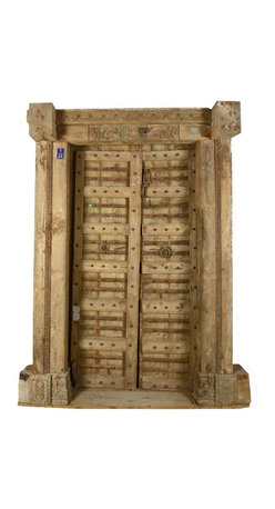 Sierra Living Concepts - Beautifully Unique Historical Teak Door - The finish of this antique style Indian door is in very good condition. This 12 pane door is classic Indian architecture. The original owner was a man of high status as is evident by the number of metal knobs. The top piece is exquisitely carved and detailed.