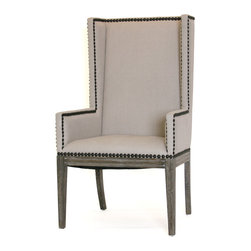 Nailhead Dining Chair - Arms - Settle into this wingback armchair designed for the dining table. Clean-looking natural linen upholstery on the back, seat, and narrow arms is outlined in old-world nailhead trim, while tall, square saber-style legs give the chair an unexpected airy elegance. The wood portions of the beautiful neutral-colored occasional chair are labor-intensive old-world cerused oak. Impressive and substantial, the transitional dining chair easily and glamorously fits into rustic dining rooms or elegant breakfast nooks. For a more casual look, mix it with the armless version.