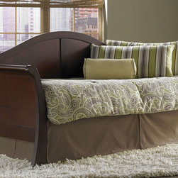 "Fashion Bed Group - Stratford Daybed With Link in Mahogany Finish - The Stratford Daybed can be considered a traditional Louis Philippe sleigh style because of its camelback-shaped rear panel and curved arms, but where it departs from that classification is the widened stance of the post bottoms, which adds an Asian flair. With that flared touch, the design is updated almost to the brink of contemporary. The lines are simple and clean; a series of curves formed into a daybed. The stance of the Stratford is quite wide. The curve of the tops of the arms stretch the back out to 91"", and the height of the top of the back is 44"". The arms are a standard 40"" wide to house a regulation twin mattress. The daybed is made of an Asian hardwood and finished in a deep Mahogany color. It can accommodate an optional trundle unit, for additional sleeping."