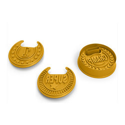 Fred & Friends - Top Cookie Cookie Cutters - We are the chompions! Celebrate your victory the best way possible - with a cookie! Top Cookie includes a medal-shaped cookie cutter, 3 stamps, and 3 ribbon necklaces. A fun and unique way to show love to the champs in your life!