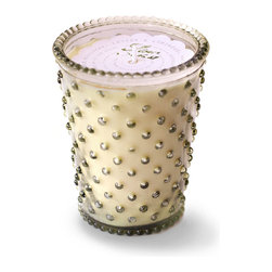 Stem Hobnail Glass Candle - The simplicity of the scented candle is celebrated in this novel gift or home accent, the Stem Hobnail Glass Candle. Its vegetable-based wax, which is made from renewable U.S.-grown botanicals, is fragranced with an unexpected but pleasing mix of arugula, muguet, and tarragon with base notes of sandalwood and pepper; when the wax melts away, the pressed glass holder remains.