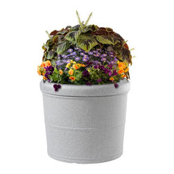 DMC - Self-Watering 16 Gallon Round Earth Planter - Rolled Rim - 95106 - Shop for Planters and Pottery from Hayneedle.com! About EarthPlanterOptimizing the balance between technology size design and functionality EarthPlanters are the result of ten years of research. These planter are successful because of a patent pending RapidWick watering system that delivers the nutrients your plants need automatically. RapidWick goes to work immediately and adjusts the water flow rate automatically as moisture demands change due to weather conditions. Each planter has a planting tray for soil-less mixture and this design promotes a deep even distribution of water to achieve great results. A large water reservoir lets you go anywhere between one week to two months between watering. Refill periods depend on size of planter (smaller need more frequent refills) and environmental conditions. An overflow assembly means your planter can never be overfilled. All the guesswork is taken out so there's no risk of under-or over-watering your plants and the proper amount of water air and nutrients are delivered to the root system at all times. Plants will thrive and daily maintenance is eliminated.