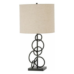 "CST901404 - Metal Circles Table Lamp With A Vintage Bronze Finish And Beige Linen Drum Shade - Metal circles Table lamp with a vintage bronze finish and beige linen drum shade.   Measures12"" x 12"" x 26"" H.  Some assembly required."