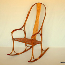 Mobius Rocker - This Rocker advances the Art of Woodworking.  Through innovative technique, it reduces the number of distinct parts required to three.  Chassis, seat and splat.  Sparse construction belies the strength of the piece.  The grace and lightness congers the tree from which its' material is derived.