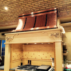 Copper Range Hoods - Custom Copper Wide Camillia Range Hood with iron straps and copper buttons. Custom designed to fit any kitchen need.