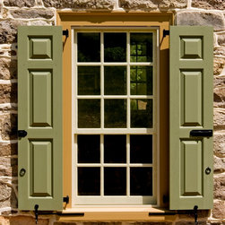 Shutters - These are traditional raised panel shutters.  Mortise and tenon construction.  We also built the solid oak window buck and reproduction window sash.
