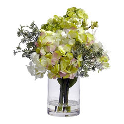 Nearly Natural - Hydrangea Silk Flower Arrangement - Just the right size to brighten any space. Delicate Hydrangeas in a dainty vase. No watering or maintenance needed. Construction Material: Polyester material, plastic, Iron, Glass. 10 in. W x 10 in. D x 14 in. H ( 1.5 lbs. ). Pot Size: 4 in. W x 6 in.HPoofy, Pretty, and Perfect, this Hydrangea silk flower arrangement will please flower lovers everywhere. Several intriguing Hydrangea blooms spout forth from a simple clear vase (complete with liquid illusion faux water), creating a look that will brighten up any area it adorns. And best of all? The sunny look will brighten your home or office for a lifetime!