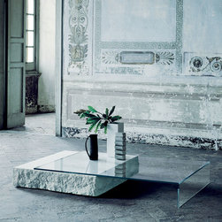Glas Italia - Glas Italia Terraliquida Coffee Table - A coffee table composed of a parallel-piped Limestone Block with a monolithic appearance and an element in tempered transparent extra light glass that rests on it.  The Limestone block has sides in a split-face-finish, whereas the top is flamed and smooth.  Price includes shipping to the USA.  Manufactured by Glas Italia.