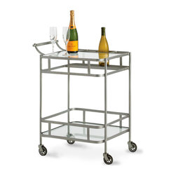 Maddox Bar Cart - Nickel - A gallery rail around the undershelf of the Maddox Bar Cart in Nickel is mirrored by the apron surrounding the top, creating a geometric and somewhat neo-Classical look refreshed by rounded corners and the Art Deco-inspired sweep of the handle.  Ideal for small dining rooms and kitchens, this cart feels clean and handsome wherever additional surface space is needed.