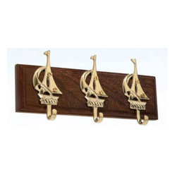 """Brass Sailboats Hanger - The brass sailboats hanger is available in size 8"""" x 3.5"""". It is made of solid, polished brass, mounted to a wood base and made to last. It will add a definite nautical touch to wherever it is placed and is a must have for those who appreciate high quality nautical decor. It makes a great gift, impressive decoration and will be admired by all those who love the sea."""