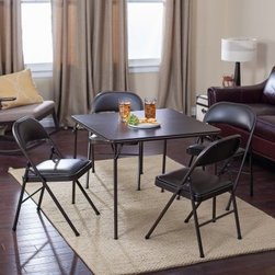 Meco Sudden Comfort Deluxe Double Padded Chair and Back- 5 Piece Card Table Set - Just because there's no room left at the real dining room table doesn't mean your secondary seating area should feel well secondary. The Sudden Comfort 5-Piece Card Table Set - Cinnabar Brown may be simple but it has a warm brown hue and comfortable padded seats to make your extra guests feel like a valuable part of the party. The classic square card table has a sturdy steel frame supporting a hardboard top. The legs fold flat for storage and have E-Z action slide leg locks for quick set up or tear down. Both the extra-wide seats and contoured backs of the four included chairs are padded with 1.5-inch-thick high density foam. The quality Y-frame design and triple-welded leg braces guarantee that the chairs won't collapse even after a hefty meal. The table top and the padded chair seats are covered in vinyl which quickly wipes clean in the likely event of food and drink spills. Non-marring leg caps prevent the table and chairs from scuffing your floors or snagging on the carpet.