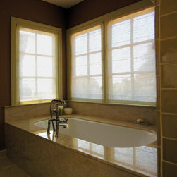 Bathroom sheers allow for privacy but let light in - Subtle custom sheer shades provide privacy but still allow light to transmit, providing a sanctuary for your bath.