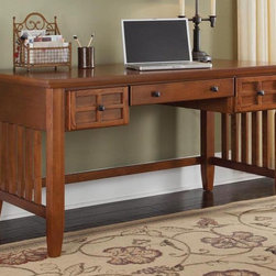 HomeStyles - 54 in. Executive Desk (Cottage Oak) - Finish: Cottage OakEmbellishes typical mission style. Lattice moldings. Slightly flared legs. The drop-front center drawer can be used as a keyboard tray. Two additional storage drawers on each side. Top coat will help to protect against wear and tear from normal use. Black hardware. Made from Asian hardwood and veneer. 54 in. W x 28 in. D x 30 in. H. Assembly Instructions