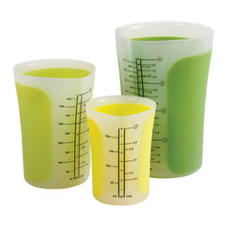 Chef'n - SleekStor® Pinch + Pour™ Measuring Beakers - 3 piece Set w/ lids, Green Tonal - Beakers aren't just for chemists and Walter White any longer. Now you can cook up your own delicious batch of chocolate chip cookies and feel like a mad scientist at the same time! These durable (and adorable) measuring beakers are made with heat and stain resistant silicone, making them fool-proof in the kitchen. They've also got snazzy pinch-activated spouts, so you can keep drippy messes to a minimum. If that's not advanced science, we don't know what is!