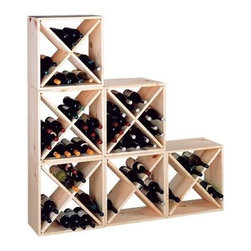 Country Pine Series Storage Wine Cube - The Country Pine Series Storage Cube is affordable sturdy stackable and expandable. This wine storage cube is made of pine which is best known for its rustic beauty. Pine is characterized by its soft creamy color combined with subtle streaks and small knot patterns. Each of the four compartments inside each cube holds six bottles for a total of 24 bottles of wine per cube. Assembly is easy with just eight screws. As your wine collection grows add as many cubes as you need. Assembly instructions and all necessary hardware are included. Shown in a set of six cubes. Buy more and save! About Wine Cellar InnovationsWine Cellar Innovations is the world's foremost designer and manufacturer of custom wine cellars and wine racks. Founded more than 20 years ago Wine Cellar Innovations continues to offer creative and functional wine storage solutions while expanding new horizons in refrigeration 3D color design and 3D virtual reality walk-throughs. Wine Cellar Innovations is located in Cincinnati Ohio.
