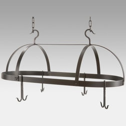 Oval Dutch Pot Rack with 8 Slip Hooks - Large - Do you find yourself wishing for more cabinet space in your kitchen? Our Oval Dutch Pot Rack with Eight Slip Hooks allows you to free up cabinet space by hanging your most frequently used pots and pans. It's a lovely addition above a kitchen island and it has a clean contemporary design and adds convenience. Four double slip hooks fit around the rack's rim so your favorite pans are always handy. Crafted from hand-forged iron this pot rack has a clean attractive style in an oval shape and the natural black finish will blend in beautifully with any kitchen decor. The four double slip hooks are loose allowing you to place them in any configuration around the rim and you can purchase additional 1-foot sections of chain to accommodate high ceilings. Made in the USA. Dimensions: 36L x 20W x 14H inches. Weighs 29 pounds.About Stone County Ironworks.Stone County Ironworks creates heirloom hand-forged iron furniture. The company's blacksmiths use artistic ability and traditional tools like the hammer anvil and forge to create unique works of art naturally. For 30 years Stone County Ironworks has worked with designers and dreamers all over the country - sometimes forging through a completed drawing provided by a client and sometimes working only with an idea to discover and create just the right design. The company's quality workmanship that reflects the skill of the blacksmith continues to set it apart from other manufacturers.