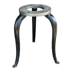 "Vintage Steel Machine Pedestals - These vintage machine pedestals will make the perfect bases to complete an industrial chic table of your own design. Made of solid steel and painted black, the seemingly delicate cabriole legs bely their stout construction. Each base measures 26.25"" in height, with a top diameter of 13"" and a leg width of 24""."