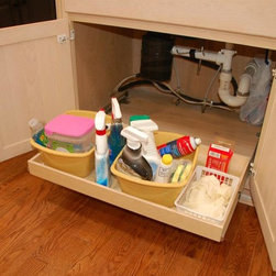 Under-Sink Pull Out Shelves - There are always a few obstacles in the cabinet beneath a sink.  Because our pull out shelves are custom made, we can work around those obstacles.