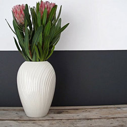Vintage White Ceramic Vase by Snapshot Vintage - A white ceramic vase is the perfect accent piece for a desk, bookshelf, side table or kitchen counter. Fill it with beautifully colored flowers and enjoy! I love the texture on this guy.