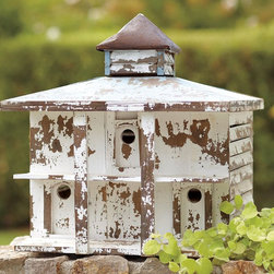 Weathered Birdhouse - A weathered birdhouse creates an immediate eclectic mood.