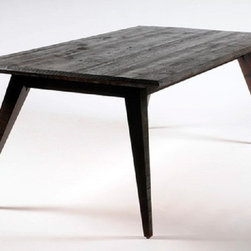 The Hemingway Dining Table - Like its namesake, the Hemingway table is known for stark, solid lines with a flair that comes across with multiple readings. The rough sawn oak (shown)*, reclaimed from barns across the nation's breadbasket, gives the Hemingway a solid, unrefined strength. The ebonized finish, topped with a brilliant clear lacquer adds warm and inviting overtones. The unique splayed-leg design adds an unexpected touch of fun to its function.