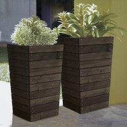 Coral Coast - Coral Coast Dark Brown Stained Planter - 16 x 16 x 27.5 in. - D11 - Shop for Planters and Pottery from Hayneedle.com! Tall and beautiful the gorgeous Coral Coast Dark Brown Stained Planter - 16 x 16 x 27.5 in. is crafted form strong and durable wood and maintains the natural look of your garden. Stained in a beautiful dark brown this planter is ideal for plants with long roots and is also great for framing a door or pathway. Its slatted base allows for easy drainage so you don't have to worry about your soil becoming too wet and killing your favorite plants or flowers. About Coral CoastWhat if when you closed your eyes you pictured yourself in your own backyard? Coral Coast has a collection of easygoing affordable outdoor accessories for your patio pool or backyard. The latest colors and styles mingle with true classics in weather-worthy fabrics and finished woods ready for relaxation. Make yours a life of leisure.