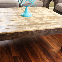 The Artsy Reclaimed Pallet Wood Coffee Table - The Artsy table was created by our 16 year old son Xander, who recently joined the Yonder Years team. He wanted to try something a little artistic with the finish and it came out so cool! Definitely one of a kind piece of furniture for your home. He used an all natural solution to create the splatter marks before sealing the entire piece.